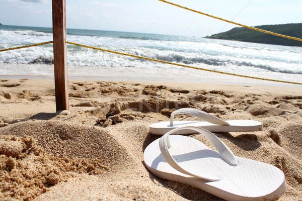 Sandálias praia branco fundo verão areia Foto stock © hayaship