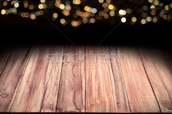 wooden table with bokeh christmas lights in background Stock photo © hayaship
