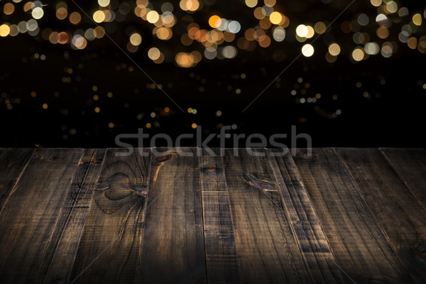 wooden table top with blurred lights in background Stock photo © hayaship