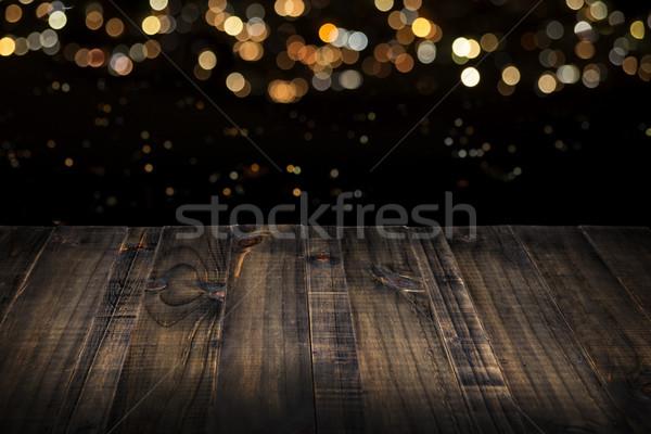 Table en bois haut floue lumières rustique noir Photo stock © hayaship