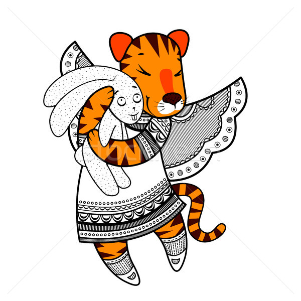 Lovely tiger with wings in beautiful clothes with a plush rabbit in the paws. Stock photo © heliburcka
