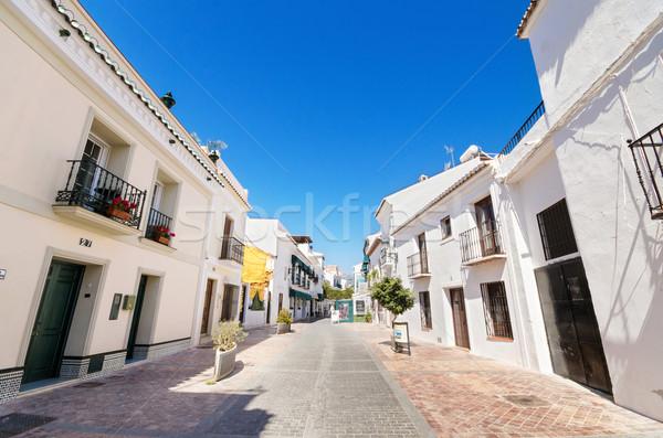 Typical street with white houses in the touristic village of Nerja, Malaga, Spain. Stock photo © HERRAEZ