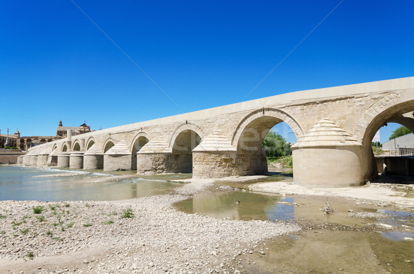 Stock photo: Roman bridge and Guadalquivir river over blue bright sky in Cordoba, Andalusia, Spain.