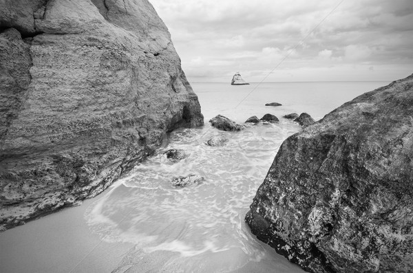Tranquil view of a coastline landscape in black and white Stock photo © HERRAEZ