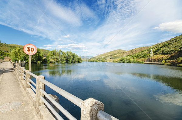 Scenic view of a road and lake in a mountain scenary.  Stock photo © HERRAEZ