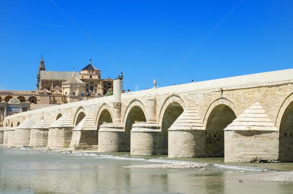 Arabic Mosque, Roman bridge and Guadalquivir river over blue bright sky in Cordoba, Andalusia, Spain Stock photo © HERRAEZ