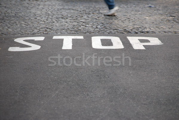 Stop - written on pavement Stock photo © HerrBullermann
