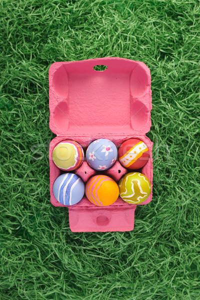 Húsvéti tojások rózsaszín doboz durva szöveg sapka Stock fotó © HerrBullermann