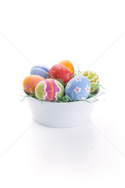 Easter eggs in white bowl Stock photo © HerrBullermann