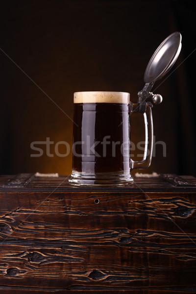 Mug of dark beer on a chest Stock photo © hiddenhallow