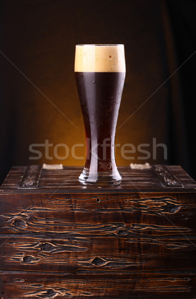 Glass of dark beer on a chest Stock photo © hiddenhallow