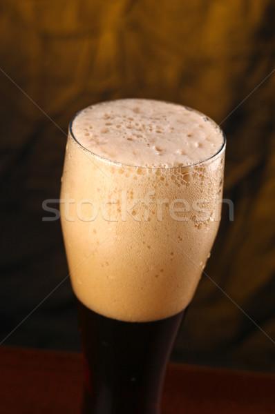 Sötét sör közelkép lövés gazdag magas Stock fotó © hiddenhallow
