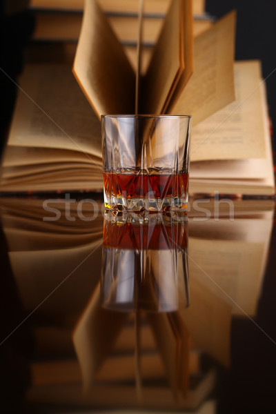 Glass of whiskey and books Stock photo © hiddenhallow