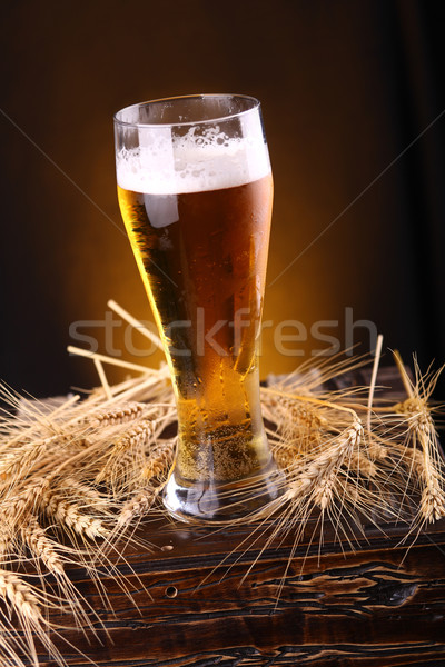 Glass of beer on a chest Stock photo © hiddenhallow