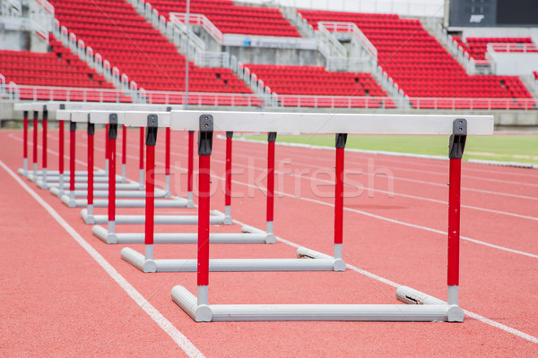 hurdles on the red running track  Stock photo © hin255