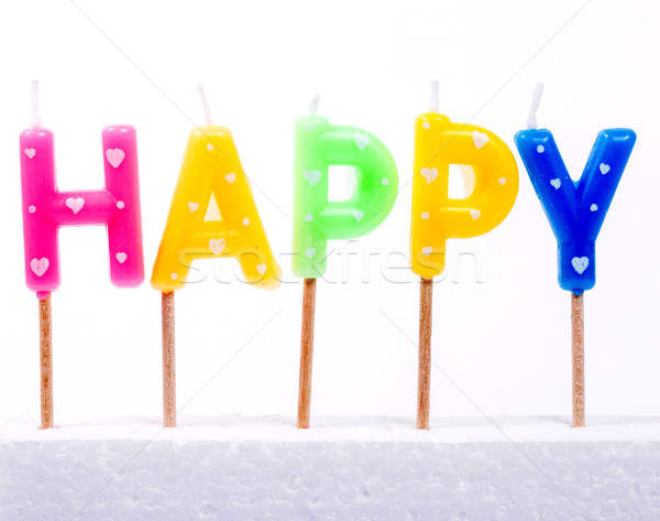 Múltiplo colorido feliz aniversário vela branco comida Foto stock © hin255