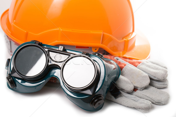 Safety hat and goggles glasses isolated  Stock photo © hin255