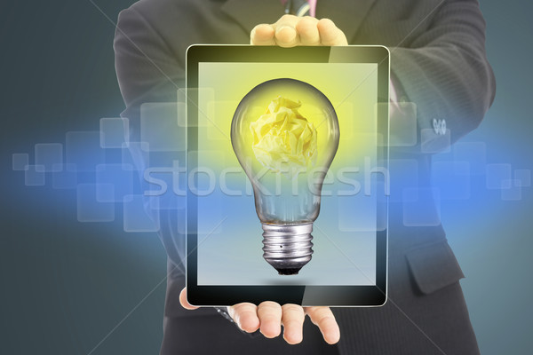 Businessman hold smart touch pad screen for presentation idea  Stock photo © hin255