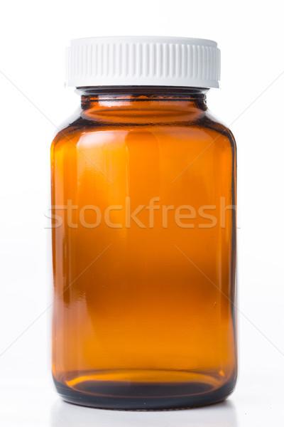 Közelkép fiola tabletták orvosi konténer fehér Stock fotó © hin255