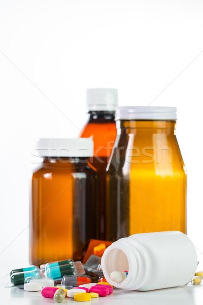 таблетки наркотиков контейнера изолированный белый фон Сток-фото © hin255