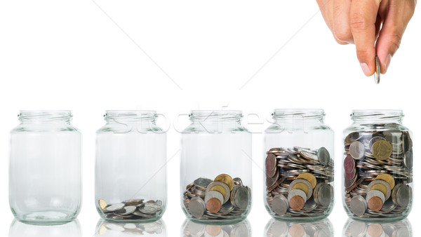 Filling up coins to glass for investment  Stock photo © hin255