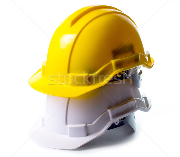 Safety hat isolated with alram clock Stock photo © hin255