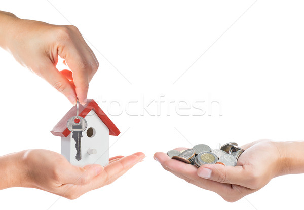 Buying property concept with giving money and key Stock photo © hin255
