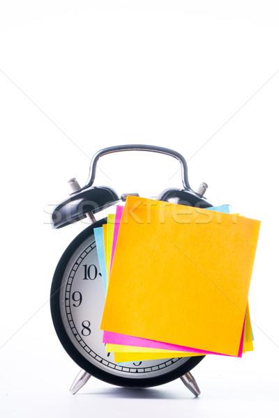 Note color paper stick on alarm clock Stock photo © hin255