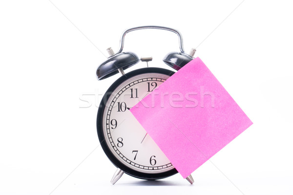 Note color paper stick on alarm clock Stock photo © hin255