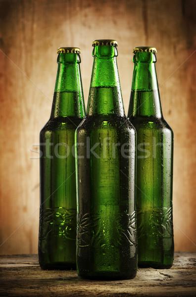 Birra bottiglie umido rustico tavolo in legno acqua Foto d'archivio © hitdelight