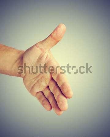 Mano offrire uomo stretta di mano business sfondo Foto d'archivio © hitdelight