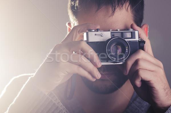Uomo retro fotocamera tecnologia sfondo Foto d'archivio © hitdelight