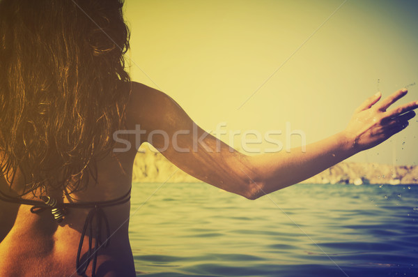 Girl in the sea Stock photo © hitdelight