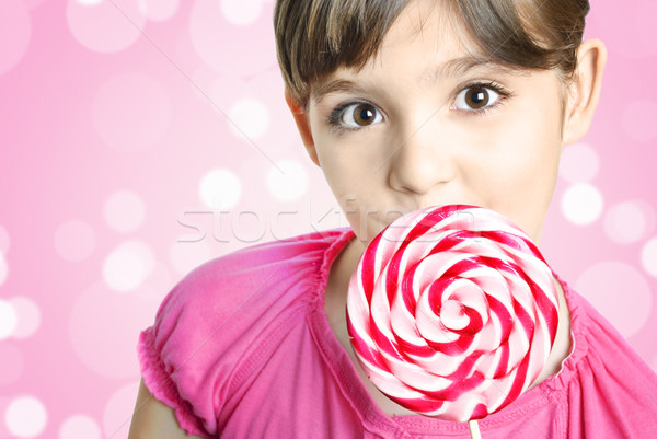 Girl with lollipop Stock photo © hitdelight