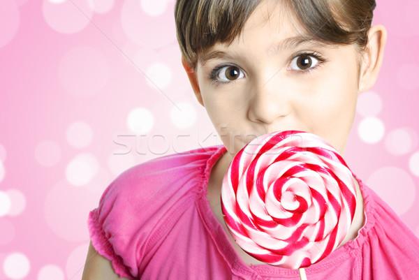 Lány nyalóka gyönyörű kislány rózsaszín étel Stock fotó © hitdelight