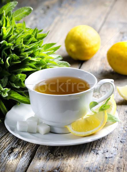 Copo chá de limão fatias Foto stock © hitdelight