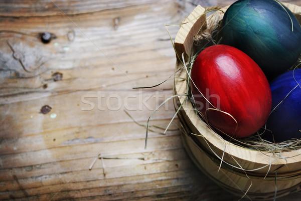 œuf de Pâques œufs de Pâques bois panier herbe Pâques Photo stock © hitdelight