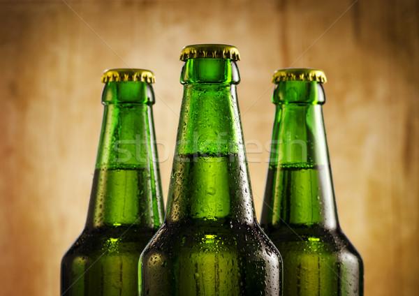 Cerveja garrafas molhado rústico água Foto stock © hitdelight