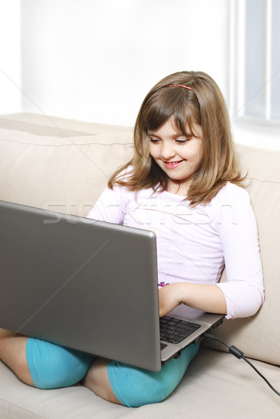 Ragazza laptop bella felice bambina computer Foto d'archivio © hitdelight