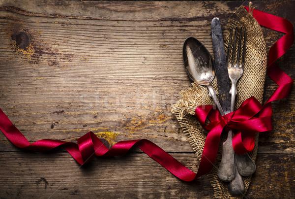 Klasszikus ezüst étkészlet díszített vörös szalag étel háttér Stock fotó © hitdelight