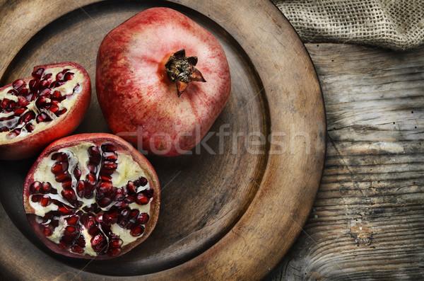 Melograno rustico legno piatto frutta vita Foto d'archivio © hitdelight