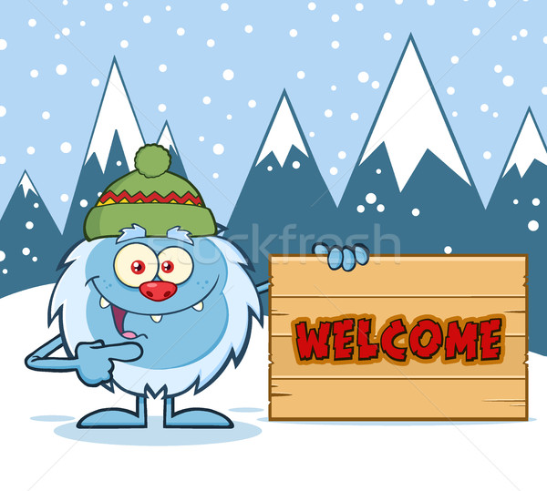 Cute Little Yeti Cartoon Mascot Character With Hat Pointing To A Welcome Wooden Sign Stock photo © hittoon