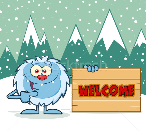 Cute Little Yeti Cartoon Mascot Character Pointing To A Welcome Wooden Sign Stock photo © hittoon