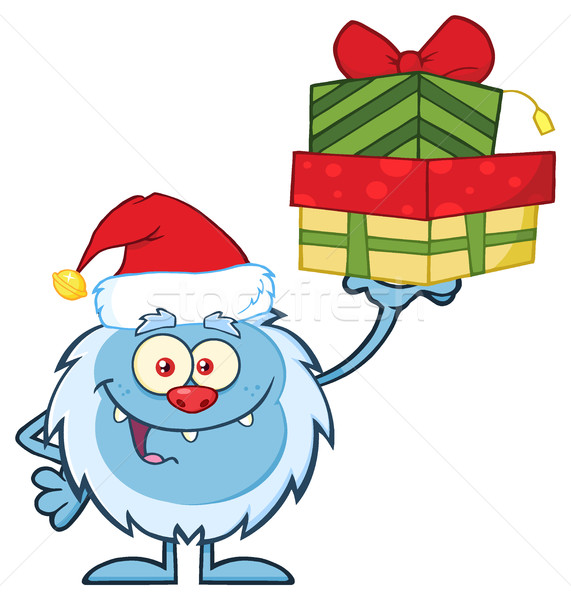 Smiling Little Yeti Cartoon Mascot Character With Santa Hat Holding Up A Gifts Stock photo © hittoon