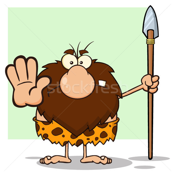 Angry Male Caveman Hunter Cartoon Mascot Character Gesturing And Standing With A Spear Stock photo © hittoon