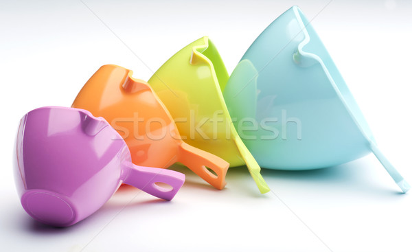 четыре пластиковых оранжевый синий Сток-фото © HJpix