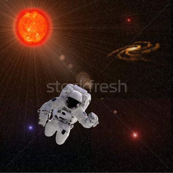 Astronaut zon sterren vliegen onderdelen afbeelding Stockfoto © hlehnerer
