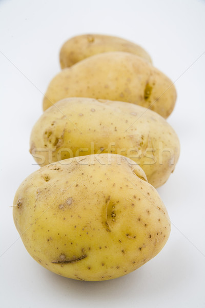 Stock photo: young potatoes on natural background