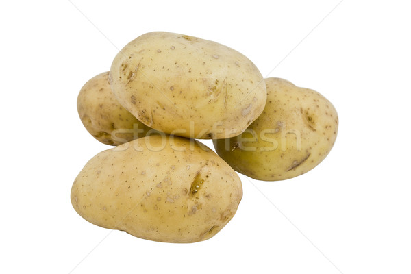 Stock photo: young potatoes on the white background