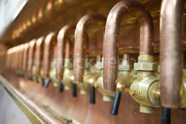 lots of taps in brewery Stock photo © Hochwander